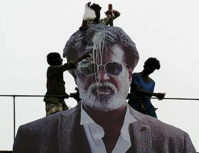 103822705_Indian_fans_pour_milk_to_bless_a_cut-out_image_of_Bollywood_star_Rajinikanth_outside_a_cin_trans_NvBQzQNjv4BqDLyVoJxGJQ4iGYZVZw1qGjW6FouhPILq15h-xiEoaNE